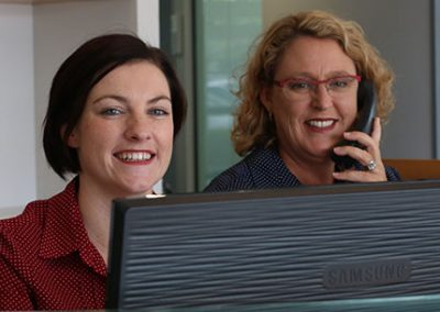 DentArana Receptionist Smiling Dentist Arana Hills
